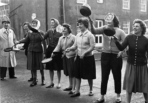 Old fashioned ladies tossing pancakes
